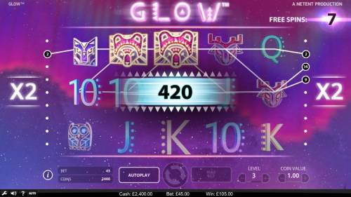 Glow Review Slots A 420 coin big win triggered by multiple winning pay lines during the free spins feature.