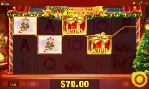 Jingle Bells Review Slots A winning Four of a Kind triggers a 70.00 win.
